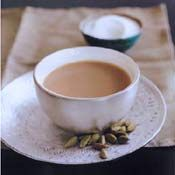 Masala Chai. Put the water in a pan. Add cinnamon, cardamom pods, and cloves. Bring mixture to a boil. Cover, turn heat to low and simmer for 10 minutes. Add the milk and sugar and bring to a simmer again. Add tea leaves, cover the pan and turn off the heat. After two minutes, strain the tea into 2 cups and serve immediately.