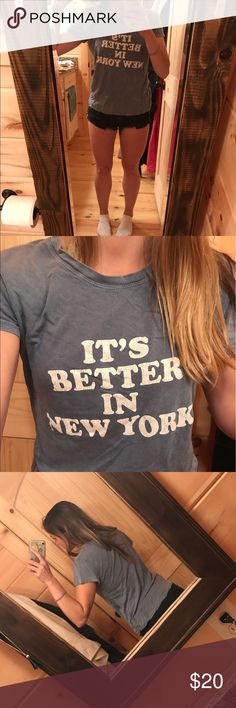 It's better in New York brandy Melville tee shirt Super comfy light weight cotton tee shirt from Brandt Melville. Worn once or twice. Like new. Slightly piling on back collar inside pictured and not noticeable , all fading came that way , one size fits a small to medium best. I'm a small for reference Brandy Melville Tops Tees - Short Sleeve