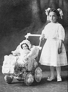 girl with doll, USA, 1911