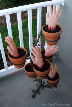 "(ha ha ... such a GREAT idea!  I just bought some ""bloody"" hands & feet at the Dollar Store ... this is what I am going to do!!!! Decor: Creepy hands in flower pots."