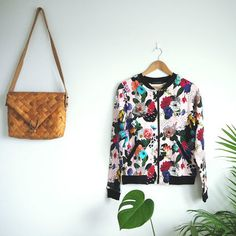The pattern design, pattern making and the product design are made by Uhana Design. Patterned Bomber Jacket, Sustainable Gifts, Laser Cut Wood, Flower Dresses, Pattern Making, Flower Patterns, Pattern Design, Organic Cotton, Knitwear