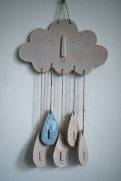 White ceramic cloud and raindrop wall hanging or mobile via Etsy.