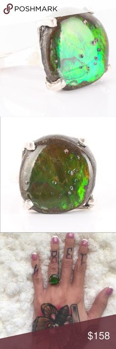 STUNNING! Sterling silver Ammolite ring size 5 This .155 ozt ammolite ring set in sterling silver is sure to take your breathe way. This ring shows stunning shades of green , red, and yellow depending on the light striking the ring. Feels very comfortable to wear no marks or dings. To me this price Screams burning man, Coachella, and bohemian woman!! Jewelry Rings