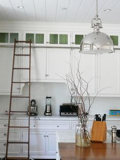 More kitchens with library ladders.