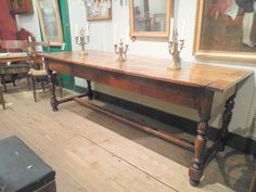 Walnut Louis XIV table with a brand mark from a convent in Lyon, two drawers.