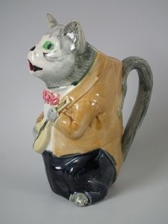 Majolica Cat with fiddle pitcher. Victorian, circa 1890.