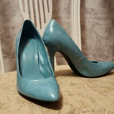 Turquoise sky high heels 4.5 inch heels in great condition. I love the color, but I am way too tall to wear these! One minor scuff on each shoe, as shown in the last pic. Mossimo Supply Co Shoes Heels
