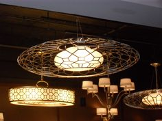 this circular lamp with patterned shade will create a variety of light directions
