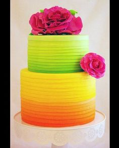Neon wedding cake in citrus and raspberry colors (Photo: Courtesy of Sugablossom Cakes)