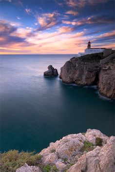 The Light House is pretty but the color of the water and the stillness of it in this photo is gorgeous!!