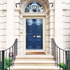 gloss navy + brass entry doors