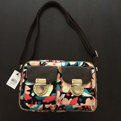 Mother's Day offer $60 Fossil Dark floral print in green, teal, white, peach and red on black background.  Taupe piping and brown leather over canvas strap that adjusts from shoulder to cross body length.  Bought at Fossil store.  Price tag attached through zipper so not opened.  Two front pockets.  100% cotton and black cotton lining. Fossil Bags Crossbody Bags