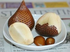 Snake Fruit - The white flesh has the consistency of peeled garlic cloves, with a sweet and acidic taste.