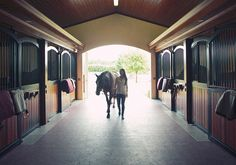 Georgina Bloomberg entering her horse stable in Wellington FL after a day of competing in the nearby Winter Equestrian Festival