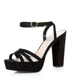 - Triple strap front- Open toe- Ankle strap fastening- Block heel- Platform sole