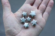 How to make origami stars from strips of newspaper.---i will make these from metal tape and turn them into earrings Diy Origami, How To Make Origami, Origami Stars, Oragami, Origami Paper, Diy Arts And Crafts, Fun Crafts, Crafts For Kids, Star Diy