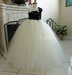 Elegant Flower Girl Dress in Black Chiffon Flowers and Ivory Tulle Skirt From: Barbee's Girls and Baby Boutique LLC www.barbeesboutique.com