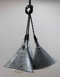 Repurposed galvanized funnel lights.