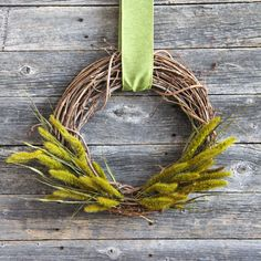 With just a few simple supplies and less than 10 minutes, you can put together this Simple Fall Grass Wreath for your home!