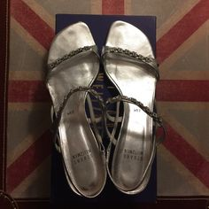 """Stuart Weitzman silver sandals- crystal accents Beautiful Stuart Weitzman silver strappy sandals. Size 8 1/2. Crystal accents on straps. Catch the light and sparkle nicely. Great for dressy occasion like a wedding. Worn twice. Wear shown on soles, and very small scuff on big toe area of left foot. 2 3/4"""" heels. Comes with original box. Stuart Weitzman Shoes Sandals"""