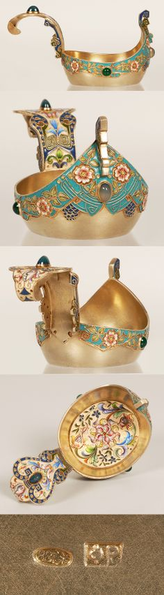 A Russian gilded silver, shaded cloisonne enamel and gemset kovsh, by Feodor Ruckert, Moscow, circa 1896-1908. Of traditional form with raised prow and handle, set with hardstone cabochons, enameled in floral and scrolling motifs on a turquoise ground and cream ground on the interior.