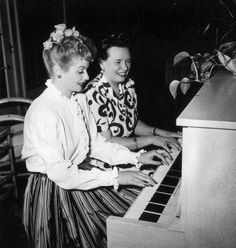 Lucy plays the piano with her mother DeDe.