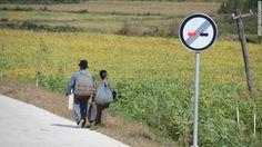 トウモロコシ畑を行く男女 ▼24Nov2013CNN|写真特集:北朝鮮に消された写真 http://www.cnn.co.jp/photo/35039724-4.html #NKorea #North_Korea #DPRK #PRK #Corea_del_Norte #Coree_du_Nord #Nordkorea