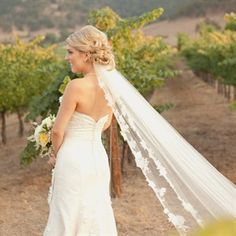 I don't know how long your veil is, but even if it shorter than this one, this hair style looks great!