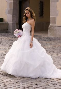 9074WStrapless organza gathered wedding dress with beaded lace corset top.
