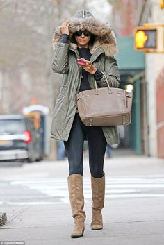 Keeping cosy: Irina Shayk kept the winter chill at bay as she wrapped up against the freez...