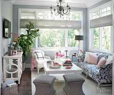 This porch imparts the ageless charm of a finely furnished drawing room. Though boasting pattern aplenty, the scene stays serene thanks to a two-tone scheme of gray and white. Set the stage for an equally timeless design by presenting the woodwork's hue as elegant, timeworn furniture finishes. Choose contoured furnishings done up in formal upholstery fabrics in colors a few tones deeper than those seen on the room's perimeter.