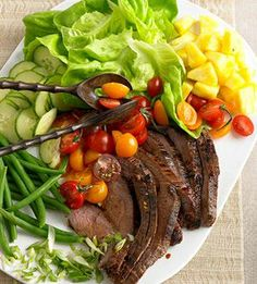 Arrange the green beans, pineapple, tomatoes, cucumber, scallions, and beef on a pretty platter for a stunning presentation of this salad at a party.