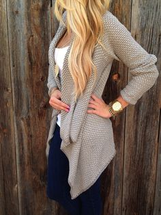 A two tone knit sweater with a cascading front hem gives a very stylish look once put it on, noble shawl neckline, long sleeves and this Fall in Love Cardigan i