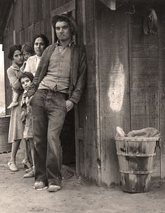The picture above was taken in 1935 and shows a destitute family at a relocation camp in California.