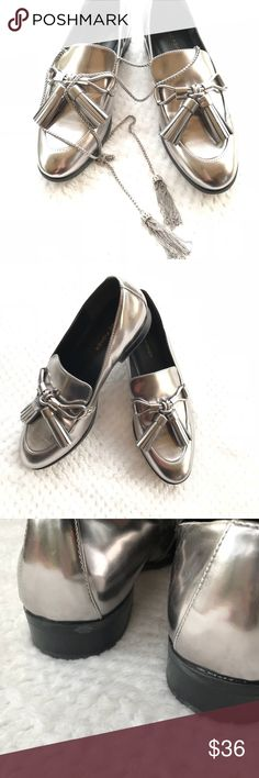 Marc Fisher silver metallic tassel loafers Sz 8 Gorgeous Marc Fisher silver metallic flat loafers with tassels. size 8. Fun, fashionable & classy shoes. Wear with jeans for skirts. There are a few small marks in tassels on right shoe (see pic). Necklace sold separately. Just used for styling. Pet and smoke free home. Marc Fisher Shoes Flats & Loafers