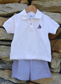 The seersucker shorts and sailboat polo set includes wide stripe navy seersucker shorts and a white polo shirt with detailed sailboat embroidery. Sizes available: 12m, 18m, 2, 3, 4, 5 & 6. Was: $52 Now: $28. Find it now at www.facebook.com/jdoriginals