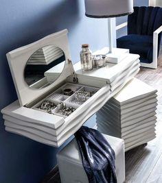 meuble coiffeuse moderne à fixer au mur, muni d'un miroir ovale rabattable, compartiment à bijoux, module à tiroirs et tabouret