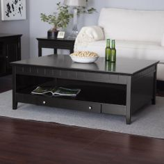 Richland Black Coffee Table Color - Black by Finley Home. $279.99. Dimensions: 48W x 36D x 18H inches. Spacious modern design with shelf and drawer storage. Quality wood veneer and durable engineered wood. Rich black finish with beadboard accents. Popular culture might have you believe the coffee table's best attribute is its wide space for coffee table books, but the Richland Black Coffee Table will set the record straight. A , this elegant transitional table - ...