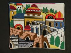 """Golden City. Hand painted needlepoint canvas. Kit contains canvas, Pearl Cotton, Metallic Thread, needle, threader and instructions.  Mesh: 13 
