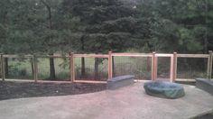 hog panel fence with wood framing