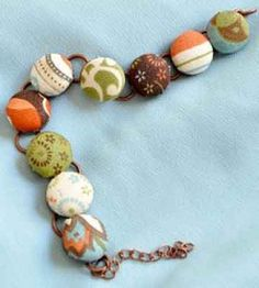 Lovely bracelet you customize by covering buttons with fabric.