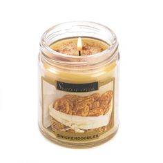 """Sugar, spice and everything nice— this candle has it all! Enjoy the scrumptious aroma of a childhood cookie classic the moment this wonderfully scented candle starts to glow. Burns up to 45 hours.7.3 oz. Made in USA. Weight 0.8 lb. 2 7/8"""" diameter x 3 1/2"""" high. Soy blend wax with lidded glass jar."""