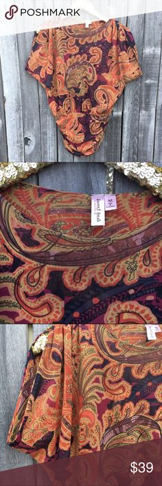 Sweet Pea Bold Paisley Blouse M BNWOT! Never worn! Beautiful, vibrant retro paisley print Tunic. Bat wing sleeves. Tunic style fitted at bottom to cover your rump! Signature Sweet Pea quality, stretch, and comfort. Effortlessly dresses up or down. Perfect for the holidays. Offers warmly welcomed! Sweet Pea Tops Blouses