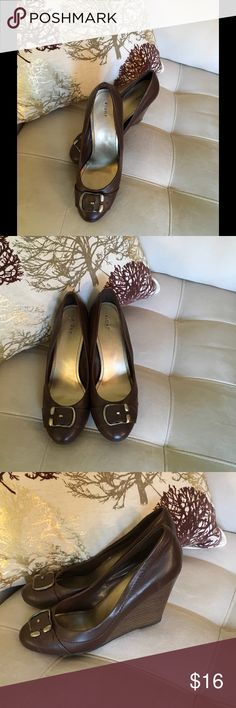 Fioni Brown Wedges Size 10 Very cute wedge heels by Fioni. Buckles on front of shoes. Overall excellent condition. Small blemish on back of one she, but not very noticeable. Size 10 FIONI Clothing Shoes Wedges