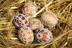 Goose Easter eggs decorated handmade lace tatting with beads Stock Photo