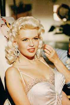 """ Jayne Mansfield getting her hair fixed on the set of The Girl Can't Help It (1956) """