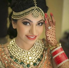 polki maatha patti , broad maatha patti , polki necklace with emerald drops , stunning necklace , rust lips , smoke eyes , peach blush  heavy jewellery , bridal jewellery , rich and luxurious , high class , royal and magnificent jewellery ,