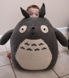 Free Knitting Pattern for Giant Totoro Toy - This large cuddly toy is inspired by the shy forest spirits portrayed in Hayao Miyazaki's Japanese animated film My Neighbor Totoro. Designed by Robin Zillman. Finished Height: 22″ Pictured project by vrankin