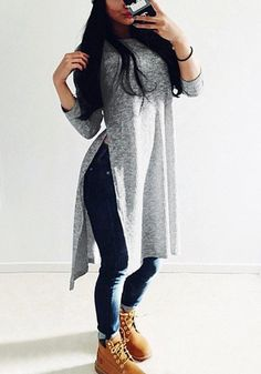 If you like it long and edgy, then this grey melange long side-split tee is for you.