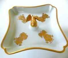"""This is a rare vintage Georges Briard plate on a a pedestal base made of white porcelain and gold gilt design. From Briard's Eldorado line, this pattern is decorated with some wonderful gold pears and pineapples, including a 3-D gold pear in the center, and gold outline around the edges. The pedestal plate measures 8 1/4"""" - 9"""" across and stands 4 1/2"""" tall; the base at the bottom is about 3 1/2"""". This is a really special discovery, very hard to find and quite unique, in mint condition…"""
